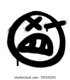 Graffiti angry emoji sprayed in black on white