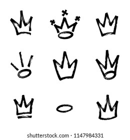 Graffiti crown set in black over white. Drawn by marker. Vector illustration. Eps 10