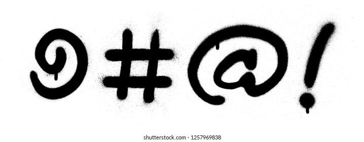 graffiti curse symbols sprayed in black over white