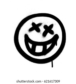 Graffiti emoji with a grin sprayed in black on white