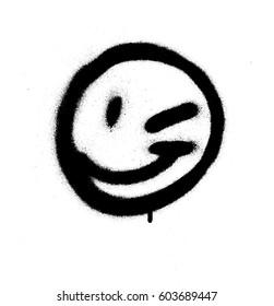 Graffiti emoticon wink face sprayed in black on white