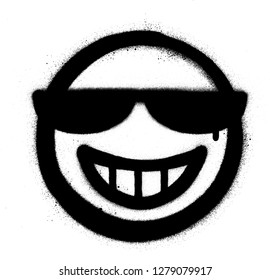 graffiti grin icon with sunglasses sprayed in black over white