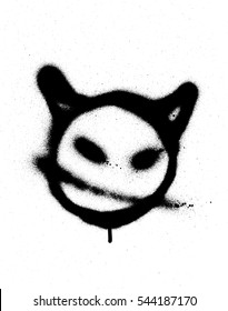 graffiti sprayed devil emoticon in black on white