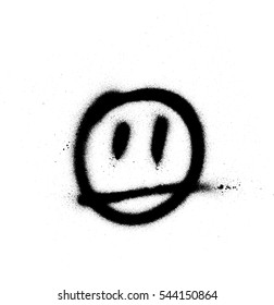 graffiti sprayed face emoticon in black on white