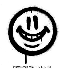 graffiti whimsical smile emojo sprayed in black on white