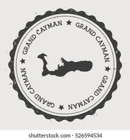 Grand Cayman vector sticker. Hipster round rubber stamp with island map. Vintage passport stamp with circular Grand Cayman text and stars, vector illustration.