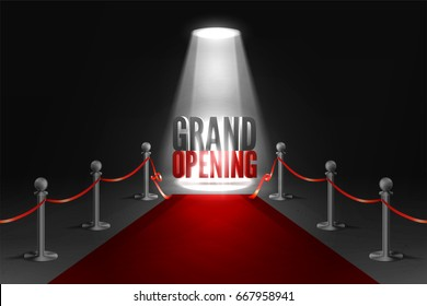 Grand opening event in spotlights. Red carpet between two barriers. Red ribbon cut ceremony.