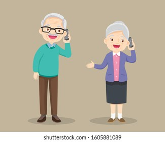 grandfather and grandmother talking on the cell phone.grandparent Speaking On The mobile phone.