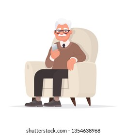 Grandfather sits in a chair and holds a phone in his hand. Vector illustration in cartoon style