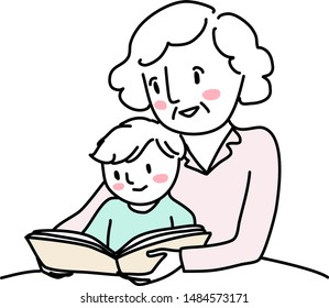 Grandmother reading bedtime story with little boy. Woman reading a storybook to her grandson. Little boy reading a storybook together with grandma. Senior woman spending happy family time with kid.