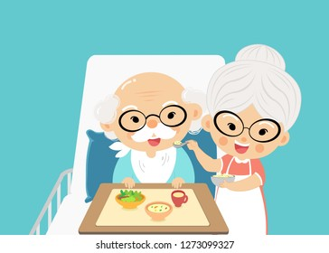 grandmother takes care of feed and take a drug the grandfather with love and concern when he sick.