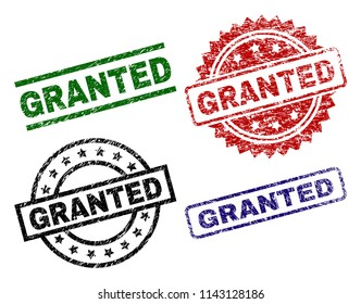 GRANTED seal prints with corroded texture. Black, green,red,blue vector rubber prints of GRANTED title with corroded texture. Rubber seals with round, rectangle, medal shapes.