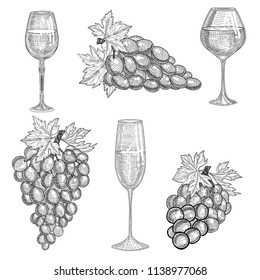Grapes and glass with grap wine.