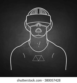 Graphic man with open mouth wearing virtual reality headset drawn in line art style. VR glasses isolated on the chalkboard. Modern cyber technologies for gaming