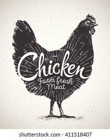 Graphical silhouette chicken and inscription.