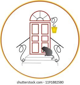 The gray cat washing itself in front of the door