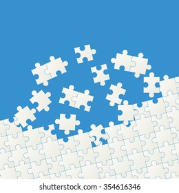 gray colored puzzle pieces on blue background