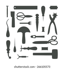 Gray leather working tools silhouettes isolated on white background