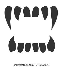 gray vampire teeth on white background