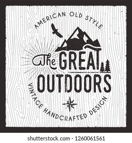The Great Outdoors card. Wanderlust Camping badge. Old hand drawn t shirt Print Apparel Graphics. Retro Typographic Custom Quote Design. Textured Stamp effect. Vintage camp style. Stock Vector emblem.
