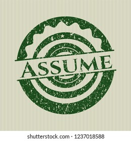 Green Assume distress rubber stamp with grunge texture