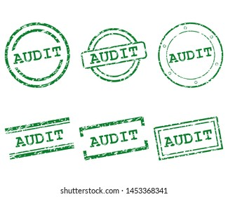 Green audit stamps on white