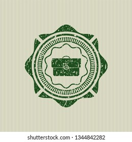Green briefcase icon inside rubber grunge stamp
