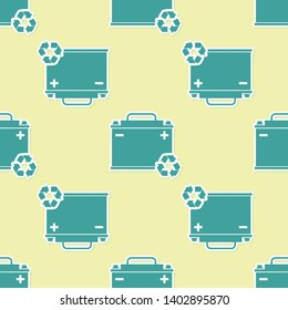 Green Car battery with recycle icon isolated seamless pattern on yellow background. Accumulator battery energy power and electricity accumulator battery. Vector Illustration