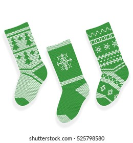 Green christmas knitted stocking isolated on white background.