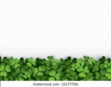 Green clover leaves at bottom