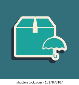 Green Delivery package with umbrella symbol icon isolated on blue background. Parcel cardboard box with umbrella sign. Logistic and delivery. Long shadow style. Vector Illustration