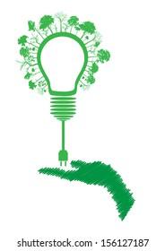 green eco energy concept, plant growing on light bulb