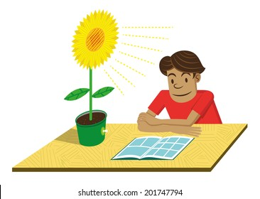 Green Energy. Boy reading a comic on a table with light like a sunflower, meaning energy from ecological sources.