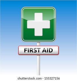Green First aid traffic board with text on blue sky background.