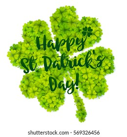 Green four-leaf lucky vector clover with calligraphic sign Happy St. Patrick's Day!