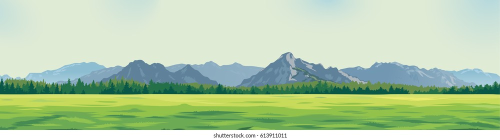 green glade against the background of mountains