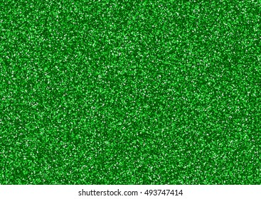 Green glitter texture background consisting of small stars.