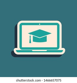 Green Graduation cap on screen laptop icon isolated on blue background. Online learning or e-learning concept. Long shadow style. Vector Illustration