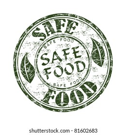 Green grunge rubber stamp with two leaves and the text safe food written inside the stamp