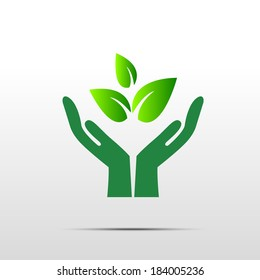 Green hand with green leaf over white background