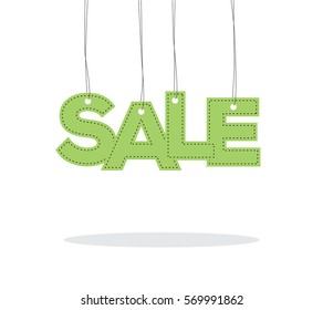 Green hanging sale word like a label tag with shadow isolated on white background, for spring sale campaigns.