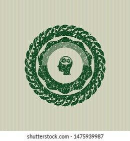 Green head with gears inside icon inside distress rubber stamp with grunge texture