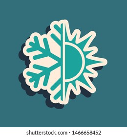 Green Hot and cold symbol. Sun and snowflake icon isolated on blue background. Winter and summer symbol. Long shadow style. Vector Illustration