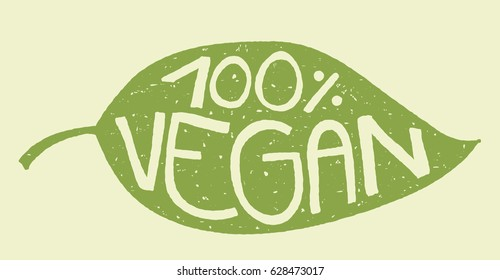 Green leaf with rubber stamp effect and hand lettering of the text 100% vegan.
