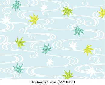 Green maple leaves on the background of blue water waves
