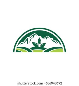 green mountain with leaf logo