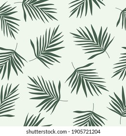 Green palm leaves silhouette on mint background. Seamless tropical patterm for fabrics, textile.Trendy  boho minimalist tropical print
