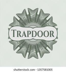 Green passport money rosette with text Trapdoor inside