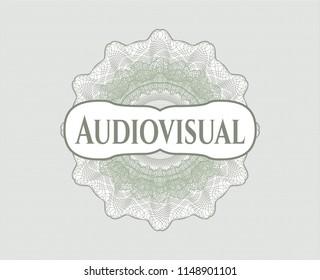 Green passport rossete with text Audiovisual inside