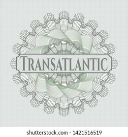 Green passport style rosette with text Transatlantic inside
